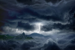 Stormy sky, lightning, mountain. Nature force background - bright lightning in dark stormy sky in mountains Stock Photos