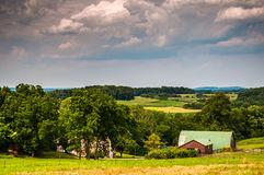 Stormy sky over a barn and farm fields in rural Southern York Co Royalty Free Stock Photos