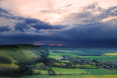 Stormy sky over bright countryside landscape Royalty Free Stock Images