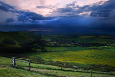 Stormy sky over bright countryside landscape Stock Images