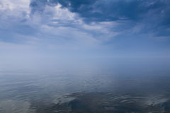 Stormy sky over calm sea Stock Photography