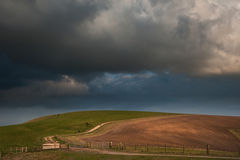 Stormy sky over countryside landscape Stock Photography