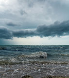 Stormy sky over dark sea Stock Photos