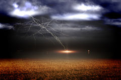 Stormy sky over field with lightning Royalty Free Stock Photo
