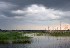 Stormy sky over the lake Royalty Free Stock Photos
