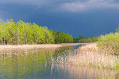 Stormy sky over a lake Stock Images