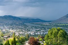 Stormy Sky over a Mountain Town on a Summer Day Royalty Free Stock Images