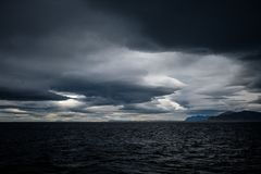 Stormy sky over an ocean Stock Images