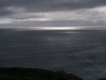 Stormy sky over the ocean. With the sun just breaking out Stock Photo