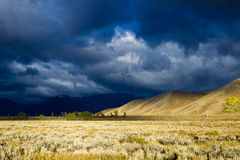 Stormy Sky Over Prarie Field. Autumn early morning picture of dark blue sky with beautiful cloud cover. Field of sage brush Royalty Free Stock Images