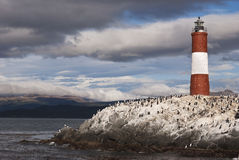 Stormy sky over red and white colored lighthouse Royalty Free Stock Photo