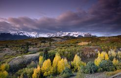 Stormy sky over San Juan Mountain range and Autumn Fall color of Dallas Divide Ridgway Colorado America Royalty Free Stock Images