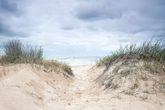 Stormy sky over the sea deserted beach. Bad weather at sea. Off Season royalty free stock photo