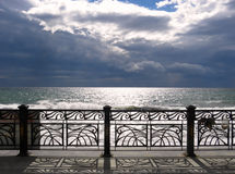 Stormy sky over the sea. Fence on the waterfront. stormy sky over the sea.Black Sea.Crimea Stock Photos