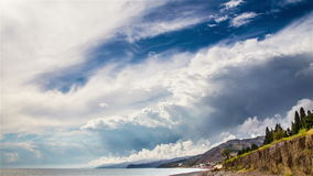 Stormy sky over sea time lapse. Stormy sky over sea and trees time lapse stock footage