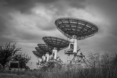 Stormy sky, radio dish array in black and white Royalty Free Stock Photo