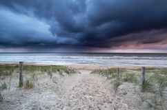 Stormy sky and showers over North sea beach Royalty Free Stock Image