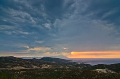 Stormy sky and sunrise at holy mountain Athos Stock Photos