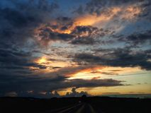 Stormy sky. And sunset royalty free stock image