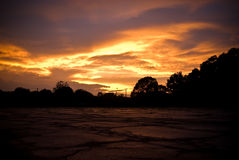 Stormy sky at sunset. A stormy sky with colorful sunset over an empty parking lot Royalty Free Stock Photo
