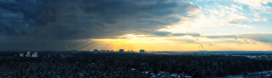 Stormy sky sunset. Over the forest and city view from a height panorama Stock Photo