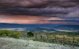 Stormy sky at sunset over San Juan Mountain range and Autumn Fall color of the Dallas Divide Ridgway Colorado Stock Images