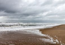 Stormy sky, surf at Assateague National Wildlife refuge royalty free stock image