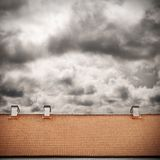 Stormy sky and tiled roof top Royalty Free Stock Photography