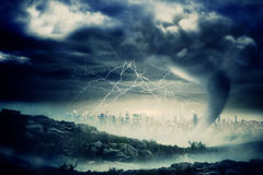 Stormy sky with tornado over cityscape Stock Photo