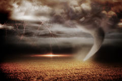 Stormy sky with tornado over field Stock Photography