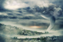 Stormy sky with tornado over landscape Stock Images