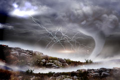 Stormy sky with tornado over landscape Royalty Free Stock Images