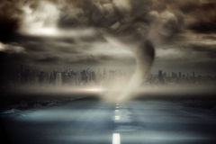 Stormy sky with tornado over road Royalty Free Stock Image