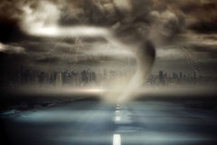 Stormy sky with tornado over road Stock Images