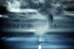 Stormy sky with tornado over road Royalty Free Stock Photos