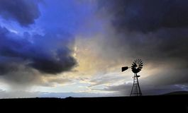 Stormy sky with windmill Stock Photo