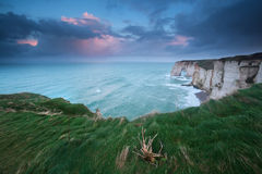 Stormy sunrise over cliffs in Atlantic ocean Royalty Free Stock Images