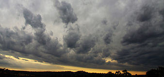 Stormy Sunset. Dramatic clouds at sunset following severe hail storm royalty free stock photography