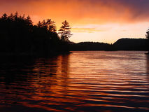 Stormy Sunset. Sunset over an Adirondack wilderness lake after a rainstorm Stock Photography