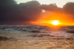 Stormy Sunset. A stormy sunset at the ocean, 15 feet waves, mountains in the background Stock Images