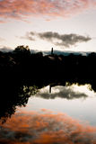 Stormy Sunset Clouds Reflected in River Stock Photo