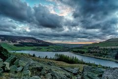 Stormy sunset over the Dove Stone Reservoir royalty free stock photo