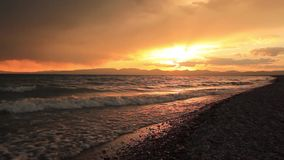 Stormy sunset over a mountain lake. Kyrgyzstan, Son-Kul lake stock footage