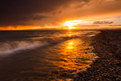 Stormy sunset over a mountain lake. Kyrgyzstan, Son-Kul lake.  Royalty Free Stock Images