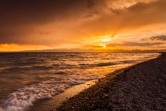 Stormy sunset over a mountain lake. Kyrgyzstan, Son-Kul lake Stock Images