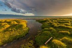 Stormy sunset over a mountain lake. Kyrgyzstan, Son-Kul lake.  Stock Image