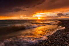 Stormy sunset over a mountain lake. Kyrgyzstan, Son-Kul lake.  Royalty Free Stock Photos