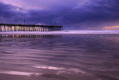 Stormy Sunset with Pier and Lights 2 Stock Image