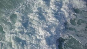 Stormy surf top view at sunny day royalty free stock images