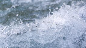 Stormy water wave as a background. In the park in nature Royalty Free Stock Images